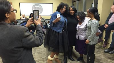 Fluker snaps picture of four women hugging each other